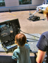 by: Eric Norberg, It was a hands-on open house at Southeast Precinct, and kids were invited to step up and navigate the bomb-disposal robot from its wireless terminal. It's run by a joystick, much like playing a videogame.