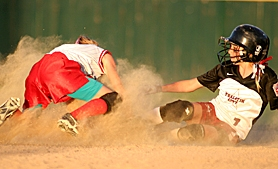 by: ROLAND SIMMONS, SAFE — Tualatin City's Shelby Burke slides into second safely for a stolen base during her team's 18-8 victory over Murrayhill Monday night at Alpenrose Stadium.
