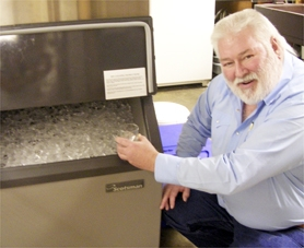 by: Nancy Townsley, Forest Grove resident Bob Browning fills up a glass with ice from a machine he and his late wife, Judy, donated to the local senior center early this month.