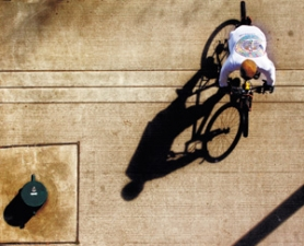 by: L.E. Baskow, A cyclist makes his way along the bike path at Gov. Tom McCall Waterfront Park near the Steel Bridge.
