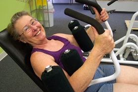 by: Photo by Bob Schoenberg/Regal Courier, Sandie Jockers works out at Curves in Tigard six days a week and works part-time evenings at her job at Fred Meyer.