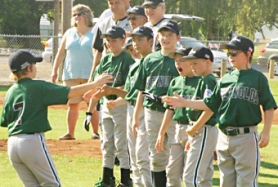 by: contributed photo, Members of the Reynolds Little League team are introduced before their 6-2 win against Pendleton to survive the elimination bracket Friday.