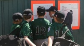 by: contributed photo, Reynolds players check out the bracket during a break in play earlier in the tournament.