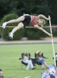 by: John Klicker, Centennial's Cayla Weissert clears 10-feet-6-inches to win the high school girls division at the Tailwinds Pole Vault competition Monday. She plans to attend the University of Oregon in the fall.