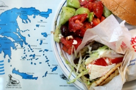 by: David Plechl, At Foti's Greek Deli visitors can take away goodies for home, or they can sit right down to gyros with feta, a side salad and just enough bread to sop it all up.