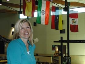 by: Jim Hart, New Rosemont Ridge Middle School Principal Debi Briggs-Crispin stands near the school's media center, where colorful flags of many nations hang over the school's central space.