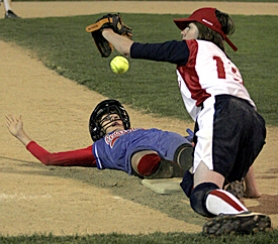 by: JAIME VALDEZ, HIT THE DIRT — Cedar Mill's Dakota Stewart slides safely into third base before scoring the tying run in the fourth inning of her team's 6-3 victory over Lake Oswego on Friday night at Alpenrose Dairy's stadium field.