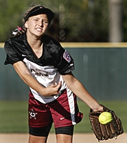 by: JAIME VALDEZ, WHIP IT — Tualatin City Little League Majors pitcher M.G. Bywater releases a pitch during her team's victory over Murrayhill n the third-place game of the District 4 tournament at Alpenrose last Friday.