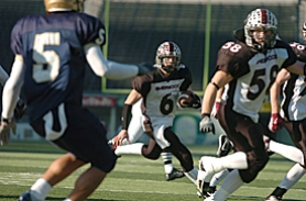 by: JAIME VALDEZ, HE'S AN ALL-STAR — Sherwood's Lukkes Gilgan (6), shown here in last year's Class 3A state championship game, will be playing in Saturday's 2006 Oregon Shrine East-West All-Star Football Game.