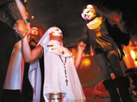 "by: L.E. Baskow, Sister Tasha Salad (middle) holds hands with Sister Anja Knees (right) and others during a recent Sisters of Perpetual Indulgence ceremony. Although the group has a social-service aim — advocating safe sex — a recent Rose City visitor decried it as a ""cheap attack on something beautiful and decent."""