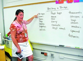 by: Barbara Sherman, THE RIGHT WORD — Lisa Murphy helps her students come up with words connected with building bridges during a lesson at Templeton Elementary.