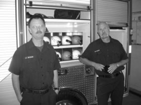 by: Cliff Newell, Brian McVicker, left, a veteran with 26 years of service in the Lake Oswego Fire Department, and Ron Baker are members of the Dive Rescue Team. This is an aspect of LOFD service that has received increased emphasis in recent years.