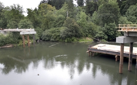 by: Jaime Valdez, VIEW OF A BRIDGE — The view from Tualatin Community Park shows how fast construction of a pedestrian/bicycle bridge is occurring over the Tualatin River.