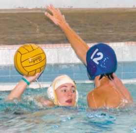 by: Shanda Tice, Eastside water polo player Danielle Hayes takes a shot against Mason Taylor during a practice last month.