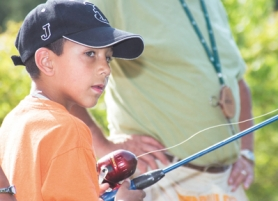 by: Shanda Tice, Camper Josiah Rodriguez, 7, fishes at Camp Agape in Corbett on Monday, Aug. 7.