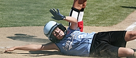 by: MILES VANCE, IN THE DIRT — Cedar Mill's Dakota Stewart slides safely home on a hit by Annie Rosser in the fourth inning of her team's 9-6 win over Canada on Monday in the Little League World Series at Alpenrose.
