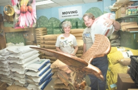 by: John Klicker, BackYard Bird Shop managers Debbie Meyers and Don Holman will move with the store to Wood Village Town Center.
