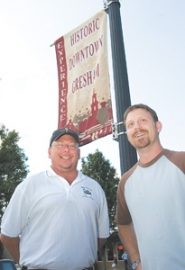 by: John Klicker, Pup Scrub owner David Jothen, left, and Cody Clark, owner of Cafe Delirium, stand beneath a new banner in historic downtown Gresham. The pair also are members of the Historic Downtown Gresham Business Association, a new group that formed to bring more visibility to the area.