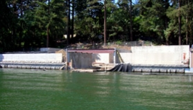 by: Lee van der Voo, These two retaining walls on the shores of a luxury development on Oswego Lake are once again putting developer Jeff Parker at odds with the city of Lake Oswego. Neighbors say the city has bent too many rules for Parker and needs to take a stand.