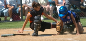 by: DAN BROOD, SERIES ACTION — Morristown, Tenn., catcher Kaylnn Doute (left) tags out EMEA's Aepril Smith Sunday during play at the 2006 Little League Softball World Series. Danelle Wiese is the assistant tourney director.