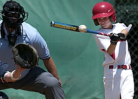 by: AL CUIZON, ON THE BALL — Murrayhill Little League's Trevor Nix connects with the pitch during the Little League Western Regional Tournament held at Al Houghton Stadium in San Bernardino, Calif., last week.