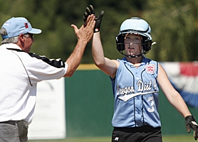 by: MILES VANCE, HIGH FIVE — Cedar Mill's Erin Gray exchanges a high five with manager Bob Ryder after hitting a two-run triple in the fourth inning of her team's 9-6 win over Canada on Monday in the Little League Softball World Series at Alpenrose.