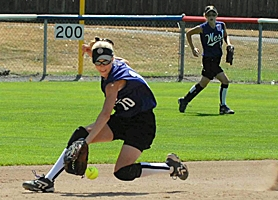 by: JIM KENCK, GOT IT — Murrayhill second baseman Sarah Atkins makes a backhand catch in the first inning of her team's win over Puerto Rico in the World Series at Kirkland, Wash.