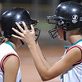 by: JIM KENCK, TEAMMATES — Murrayhill's Sarah Atkins (right) gives Katherine Casey a pep talk during their team's championship game against Alaska in the Western Regionals in Tucson, Ariz., last week.