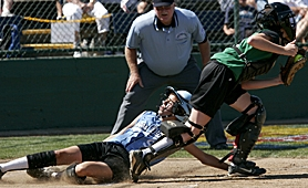 by: MILES VANCE, HIT THE BRAKES – Cedar Mill shortstop Madeline Fey slides home to score in front of East catcher Kayla Lombardo during her team's 7-4 loss on Sunday.