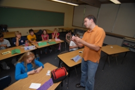 "by: Vern Uyetake, Former Lake Oswego Junior High School substitute teacher Aaron Schmidt demonstrates how to open a combination lock to a group of incoming seventh graders who will use similar locks when they start school in September. ""You will no longer be nervous, that's my guarantee,"" he told them. ""You'll be locker experts."""