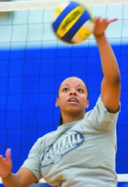 by: John Klicker, Parkrose graduate LaToya Harris returns to the Mount Hood Conference as head volleyball coach at Barlow High School. She serves a ball during a middle school camp Thursday afternoon.