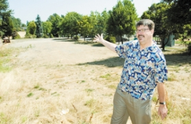 by: John Klicker, Gresham's Ric Catron points to the spot in Main City Park where the city would like to put a skate park.