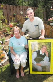 by: John Klicker, Janet and Kevin Jones hold a picture of their son, Colin who died of leukemia, in the memorial garden they have created for him outside of their Gresham home. The couple has organized a golf tournament and picnic to raise funds for a scholarship in Colin's name and for the Leukemia and Lymphoma Society.