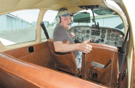 by: John Klicker, East County resident Jim Sopp sits in the cockpit of his 1961 Mooney Thursday, Aug. 10, at the Troutdale Airport. Sopp has put countless hours into restoring the plane, rebuilding the instrument panel and repainting the aircraft's exterior. Right: Sopp climbs aboard his plane, which recently took the award for Outstanding Mooney at the Experimental Aircraft Association's AirVenture event in Oshkosh, Wis.