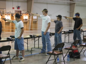 by: , Members of the Tri-County Gun Club junior rifle and pistol team take aim at their targets during the recent National Rifle Championships. Team members included, from left, Jake Adams, Robert Dow, Steven Sletten and Andrew Roland. Roland, a Lakeridge graduate, finished second in the individual competition.
