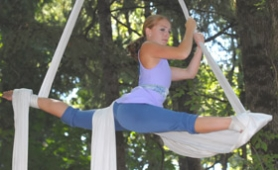 by: Vern Uyetake, Alicia Doerrie of West Linn and a member of the A-WOL aerial dance collective hangs from the trees during a performance on Saturday afternoon.