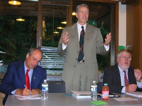 by: Cliff Newell, Rep. Greg Macpherson makes a point while Oregon Secretary of State Bill Bradbury, left, and Sen. Richard Devlin, right, listen during a Tuesday evening town hall session at Tryon Creek State Park.