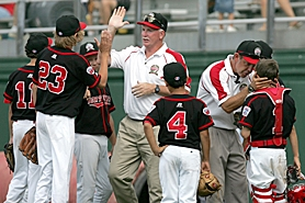 by: CHRISTOPHER WEDDLE, BACK ON TRACK — Murrayhill coach Ron Pool (center) high-fives Devon DeJardin while manager Jeff Keller congratulates catcher Trevor Nix following their win over Lake Charles, La. in pool play Sunday at the Little League World Series.