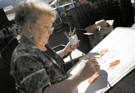 by: JAIME VALDEZ, Beaverton resident Denise McDonald was among the number of artists who took time to sketch, paint or photograph the goings-on at the Beaverton Farmers' Market as part of the Artists Against Hunger Paint Out and Art Sale.