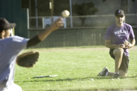 by: John Klicker, Gresham Pilots manager Jim Mott oversees a practice session Tuesday night at Gresham High School. The Pilots accepted an invitation to play in this week's Junior Baseball national championship tournament.