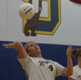 by: David Ball, Barlow senior Kristel Baeckel goes through a serving drill during a practice session Thursday morning.