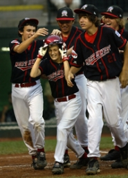 by: JAIME VALDEZ, Murrayhill's Trevor Nix celebrates after he hits a 2-run homer to tie the game 3-3 in the fourth inning against the Columbus Northern Little League team during the World Series Little League U.S. Championship game Saturday.