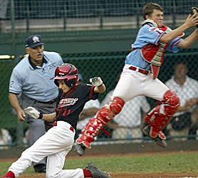 by: JAIME VALDEZ, CHAMPIONSHIP GAME — Sam Albert scores Murrayhill's first run past Georgia catcher Cody Walker in Saturday's U.S. championship game.