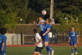 by: Vern Uyetake, Lake Oswego's Nic Watson, center, goes high for a header during the Lakers non-league against Grant on Tuesday. Despite having an advantage in time of possession, the Lakers had to settle for a 2-2 tie with both goals scored by sophomore Jackson Ray.
