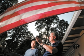 by: Jaime Valdez, Wally Johnston a chaplain with the Beaverton Police Department, chats with NYPD Officer Arnold Chow last month, recalling the events of 9/11. Johnston met Chow in December 2001. Chow's badge honors that day.