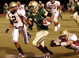 by: MILES VANCE, IN THE OPEN - Jesuit's Michael Lowe, here being chased by Central Catholic's Barry Hood (left) and Jaden Kaufman, racks up yardage during his team's 20-6 non-league home win on Friday night.