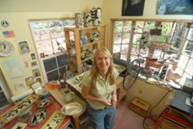 by: Vern Uyetake, West Linn's Theresa Smith creates slab pottery in her 12-by-16-foot home studio. Smith's pottery will be available this weekend in West Linn at the seventh annual Village of Willamette Arts Festival in downtown Willamette.
