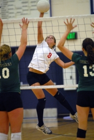 by: Vern Uyetake, Lake Oswego's Heather Anderson goes high for a kill during the Lakers' season-opening volleyball match against West Linn last Friday. West Linn won the match in straight sets.
