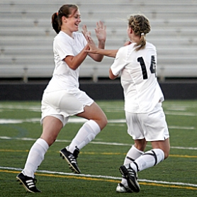 by: JONATHAN HOUSE, GOOD TIMES — Aloha's Alina Ferguson (left) and teammate Ashley Hittner celebrate Hittner's goal in the first half of their 5-1 non-league victory over Century at Aloha High School on Monday night.