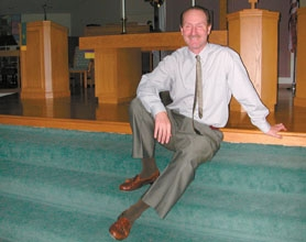 "by: Barabara Sherman, READY TO LEAD THE FLOCK — New pastor Robert Garwig sits in the sanctuary of Calvin Presbyterian Church recently, where he admitted as he walked in, ""I don't know where the light switches are,"" although he expects to soon be up to speed on the congregation and the facility."
